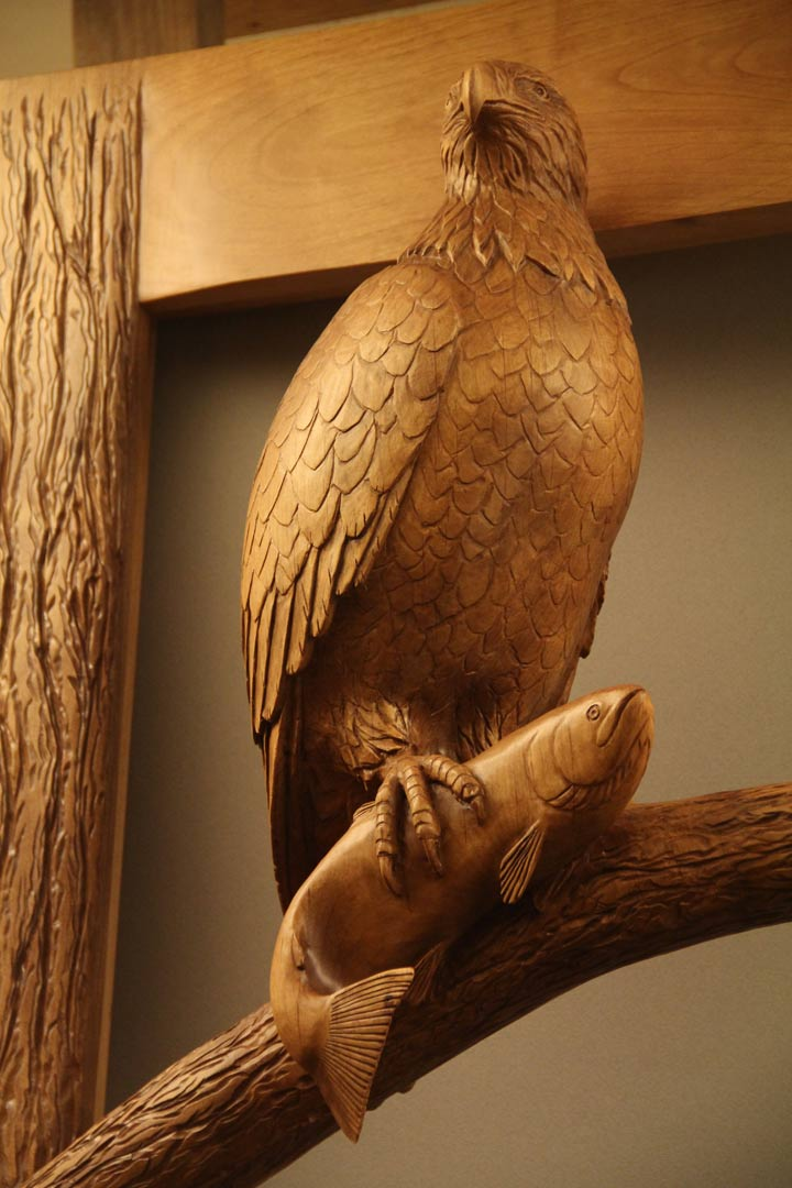 eagle sculpture holding salmon